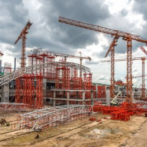 Construction Cranes Working on Expressway Site in Asia